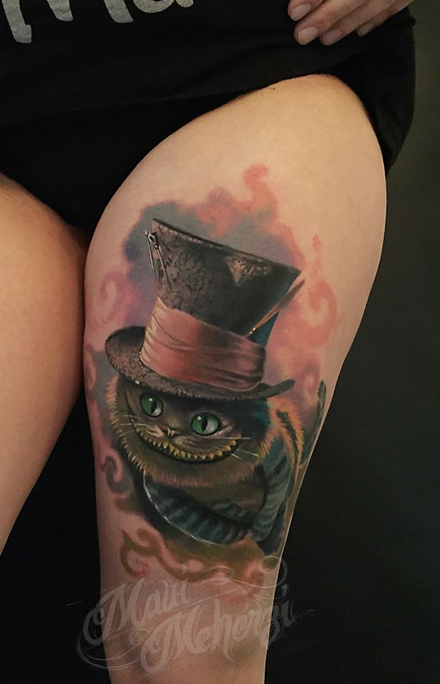 Maui Meherzi - Opus Magnum Tattoo Studio Wien - Cheshire Cat Alice in Wonderland Tattoo