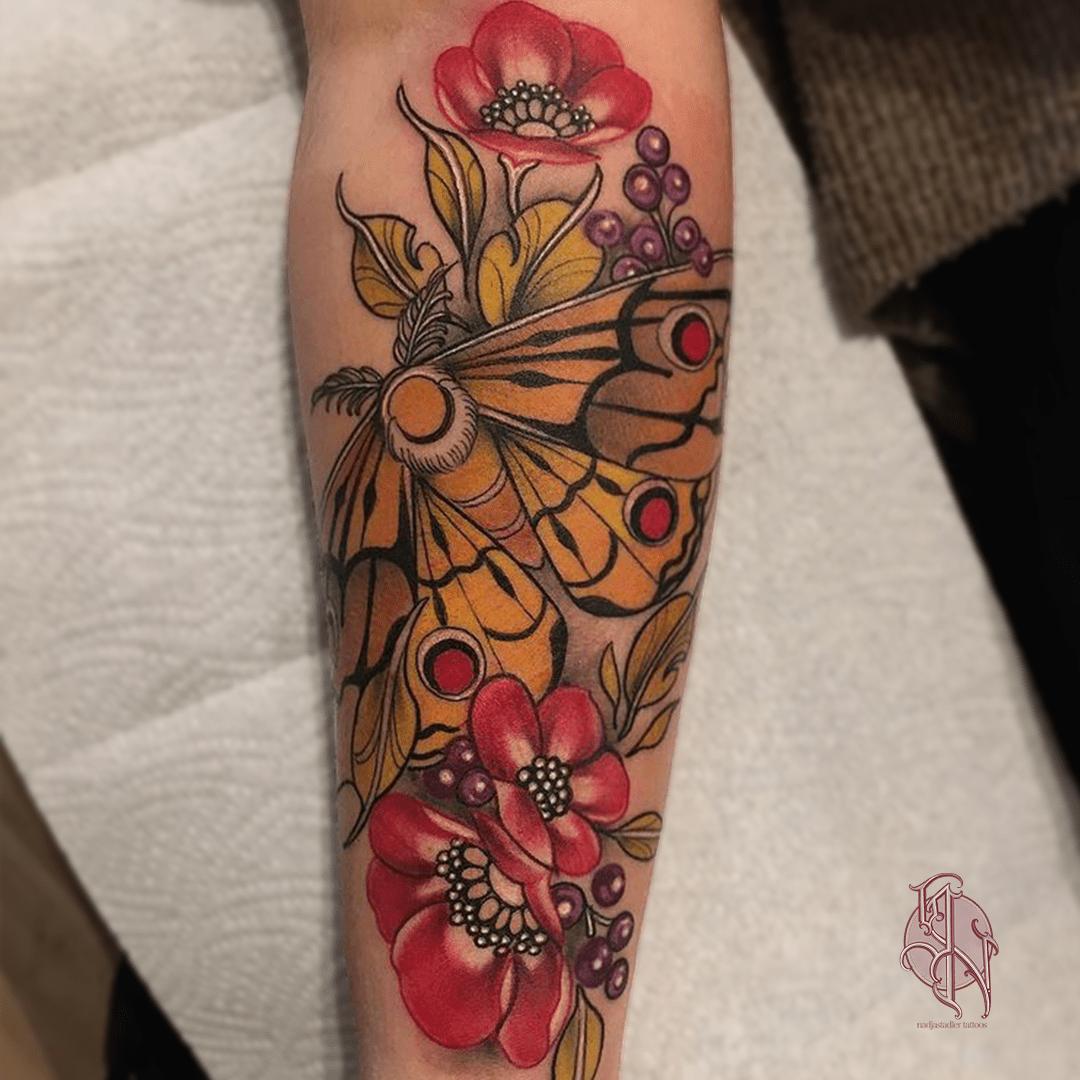 nadjastadler tattoo wien vienna opusmagnum neotraditional flower tattoo color butterfly